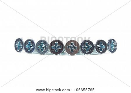 Isolated photo of bolt heads on white