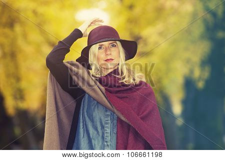 Blond Woman In A Park In Autumn