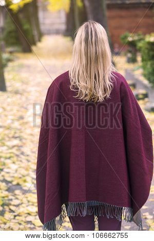 Woman Walking In Park In Fall
