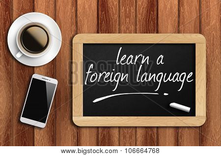 Coffee, Phone  And Chalkboard With  Word Learn A Foreign Language