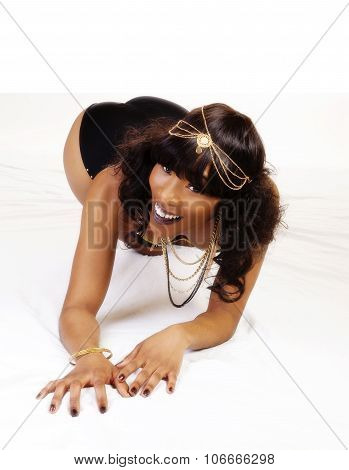 Smiling Attractive African American Woman On Knees And Elbows