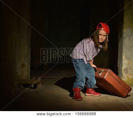Little girl in a dark cellar