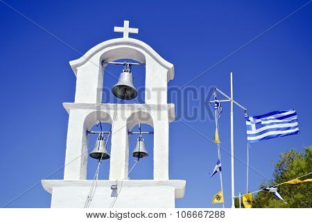 church belfry and the greek flag