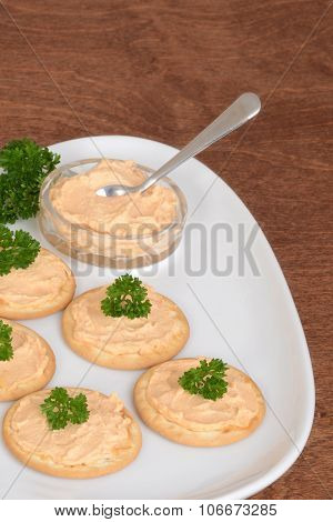 crackers salmon pate and parsley on plate