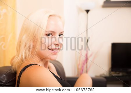Girl Relaxing On A Sofa