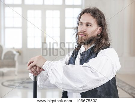 Handsome Man In Medieval Clothes With Cane
