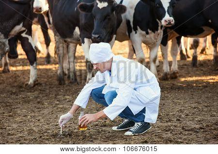 Farmer checks  biological samples