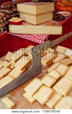 Cheese On A Cutting Board On A Market
