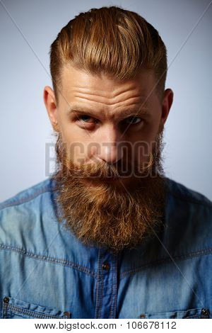 Portrait of brutal man with beard and mustache