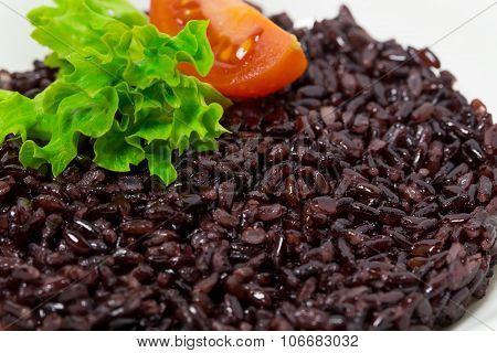 Black rice risotto with tomato.