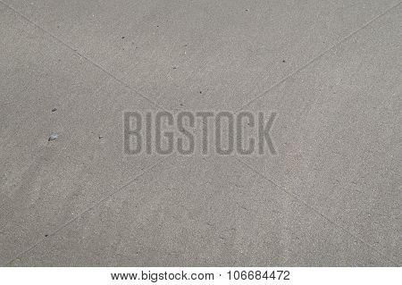 Gray wet sand background