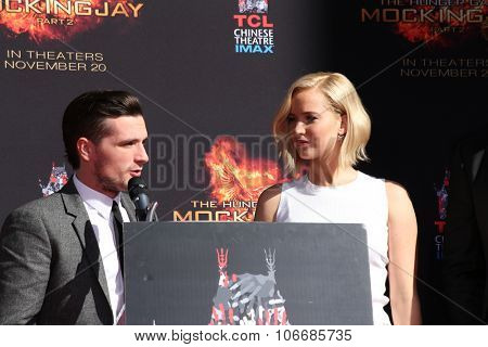 LOS ANGELES - OCT 31:  Josh Hutcherson, Jennifer Lawrence at the Hunger Games Handprint and Footprint Ceremony at the TCL Chinese Theater on October 31, 2015 in Los Angeles, CA