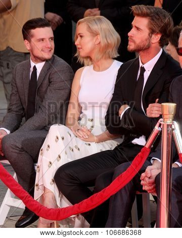 LOS ANGELES - OCT 31:  Josh Hutcherson, Jennifer Lawrence, Liam Hemsworth at the Hunger Games Handprint and Footprint Ceremony at the TCL Chinese Theater on October 31, 2015 in Los Angeles, CA