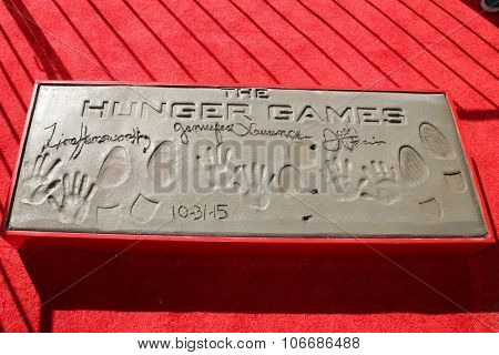 LOS ANGELES - OCT 31:  Hunger Games Handprints Footprints at the Hunger Games Handprint and Footprint Ceremony at the TCL Chinese Theater on October 31, 2015 in Los Angeles, CA