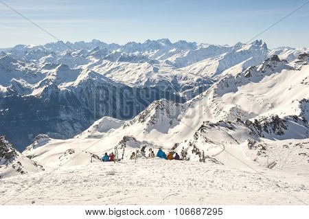 View Of An Alpine Mountain With Skiers