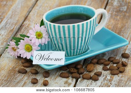 Welcome card with coffee in vintage cup and pink daisy flowers