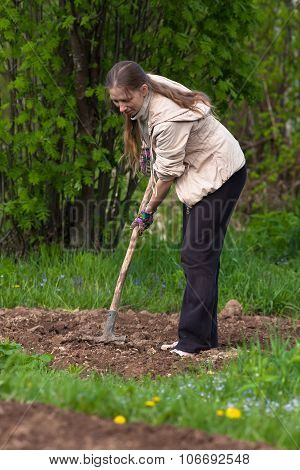 Digging Woman In The Garden