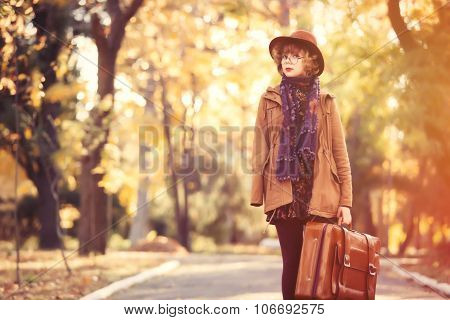 Young Girl With Bag In The Park