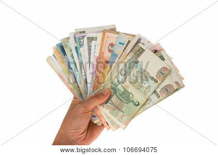 Fan of banknotes of various countries in the hand