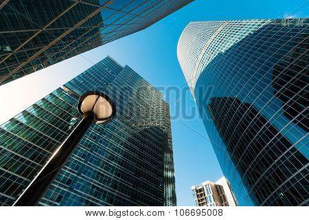 Blue skyscraper facade. office buildings. modern glass silhouett