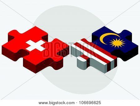 Switzerland And Malaysia Flags