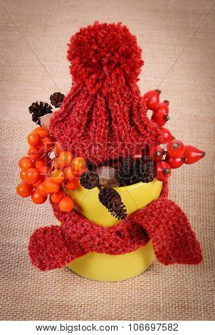 Autumn Decoration With Cup Wrapped Scarf And Woolen Cap On Burlap