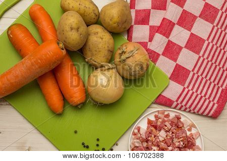 Ingredients To Make Typical Dutch Hutspot, With Carrot, Onion, And Potatoes