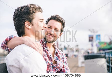 Homosexual Couple Sitting In Santa Monica Pier On A Bench