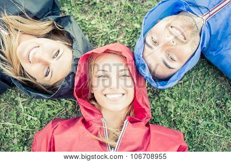 Group Of Friends Wearing Rain Jacket And Enjoying The Nature