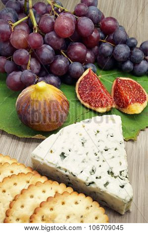 Blue Cheese Accompanied By Fruits And Crackers