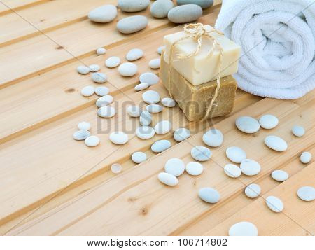 Towel, Soap And Stones On The Wooden Planks