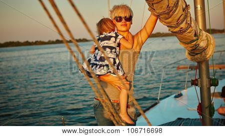 Mother, daughter on yacht.  Concept of the family