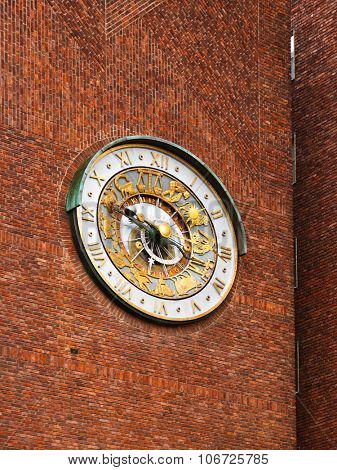 Astronomical clock on wall City Hall Radhuset - Oslo Norway