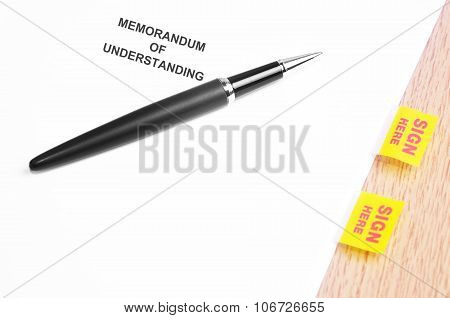 Black Pen And Memorandum Of Understanding  With Sign Here Stickers