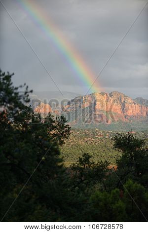 Stormy Clouds And Rainbow Over Sedona, Arizona