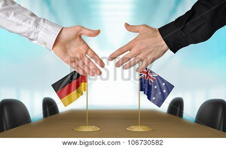 Germany and Australia diplomats agreeing on a deal