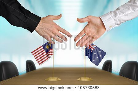 Malaysia and Australia diplomats agreeing on a deal