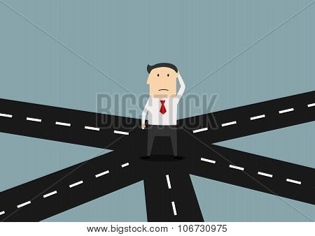 Businessman on crossroad choosing direction