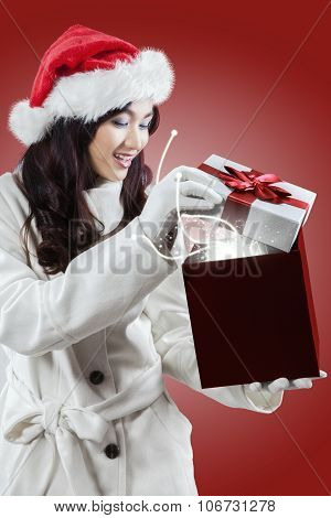 Girl Opens A Presents With Miracle Light