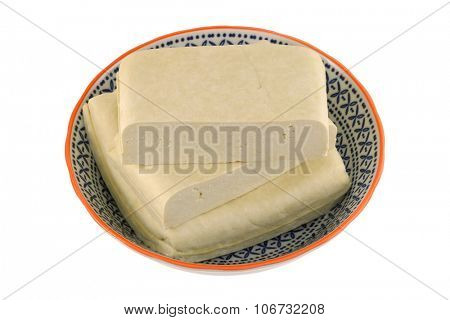 A bowl of fresh White Bean Curd (Firm Tofu), isolated on white