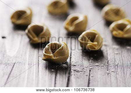 Raw Italian Tortellini On The Wooden Table
