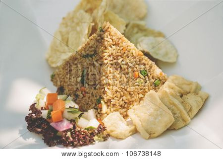 fried rice and fried tofu served with salad
