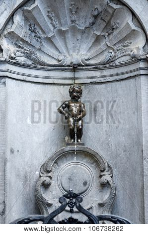Manneken Pis (little Man Pee), A Famous Bronze Sculpture In Brussels