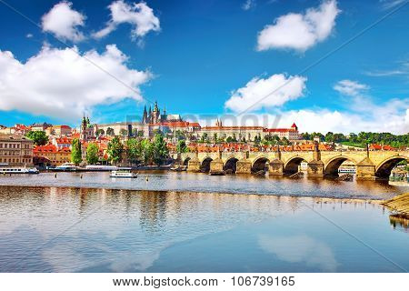 View Of Prague Castle And Charles Bridge-famous Historic Bridge That Crosses The Vltava River In Pra