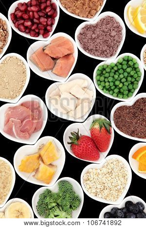 Body building high protein health food of meat and fish with supplement powders, seeds, fruit and vegetables.