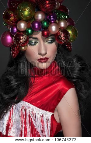 Young Beautiful Brunette Woman With  Christmas Toys Hat And Fashion Makeup