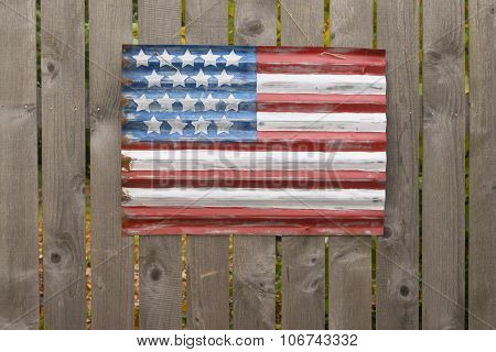Flag On A Fence