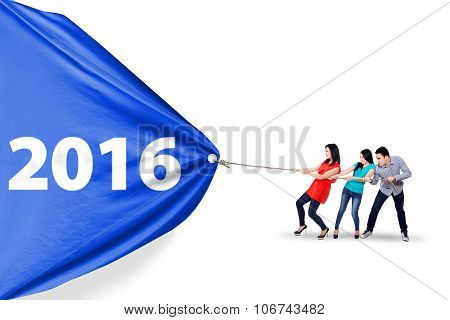 Young People Pulling Banner With Numbers 2016