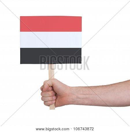 Hand Holding Small Card - Flag Of Yemen