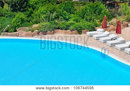 Outdoor Swimming Pool And Lush Vegetation